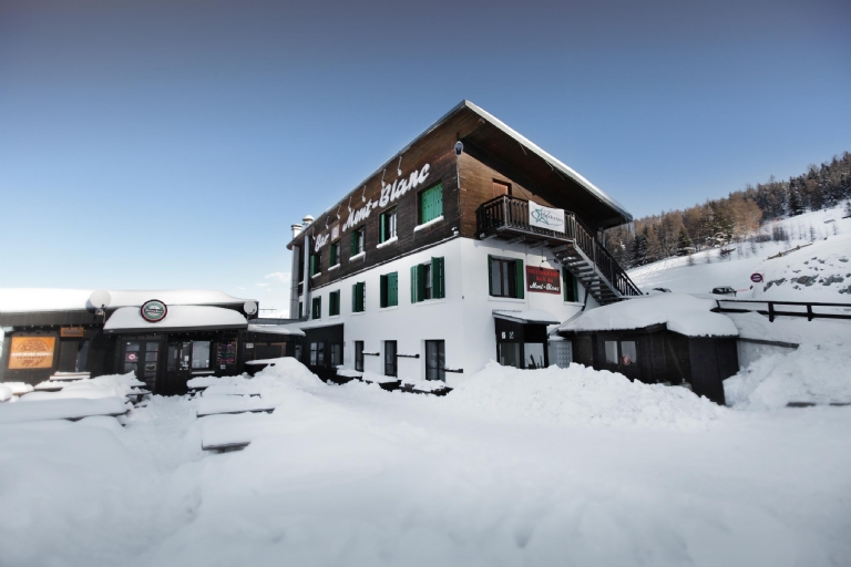Perched right next to the piste so you really can ski in and out of the door!